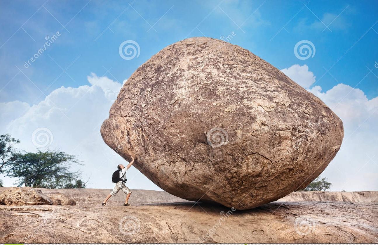 mens-die-een-grote-steen-duwen-35325137